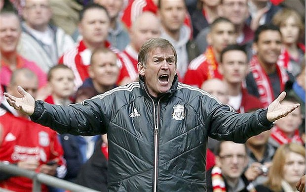 Former Liverpool manager Kenny Dalglish standing in front of the fans with arms outstretched