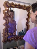 Mirror frame made from routed plywood.