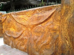 Gate, made from plywood, which had been routed to form designs.