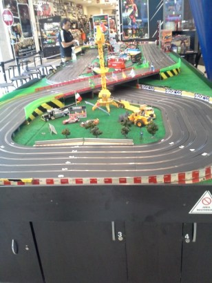 An arcade game which is racing slot cars.