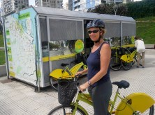 Char checks out a bike from the free bike program. There are 25 stations in the city, and you can pickup and drop off your bike in any station.