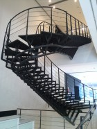 A staircase in an art gallery. It uses roller coaster construction technology to jut out into the lobby.