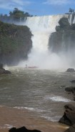 Boats routinely carry groups of about 60 tourists under the falls, completely soaking them.