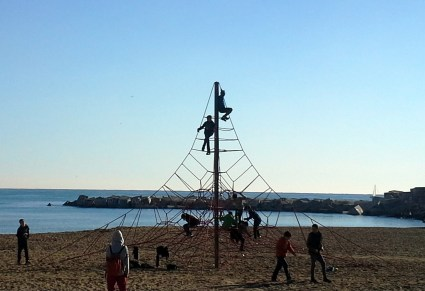 Tower play structure on the beach