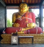 This is a statue of a monk who made himself fat because he used to be very handsome and he did wanted to be appreciated for his spiritual qualities, not his appearance.