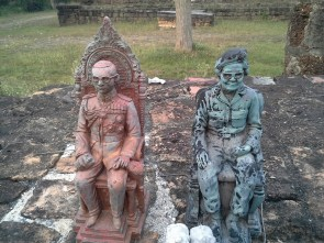 Mini sculptures of the king and someone, left at a small, unmarked temple we found on a bike trip