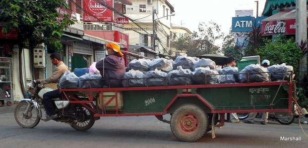 Bags of charcoal pulled by motor cycle