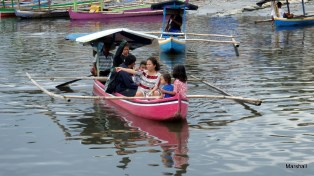 Paddle powered ferry crossing the river, Manado, Sulawesi