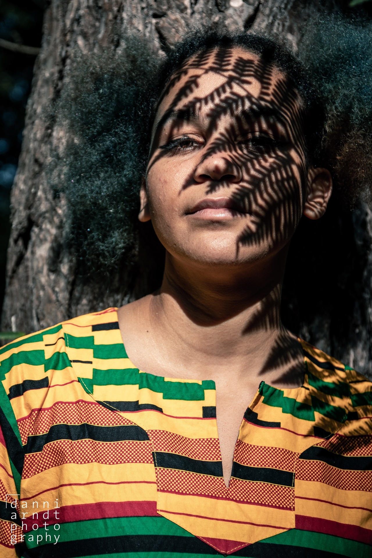 shadows of fern on an African girls face