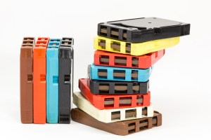 Many old 8-track audio tapes of different colors