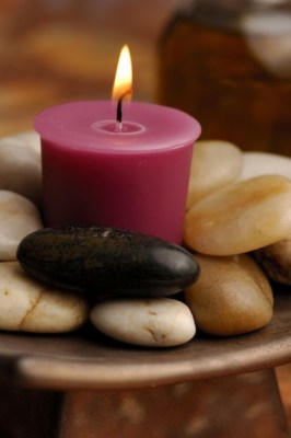 Candle and river stones