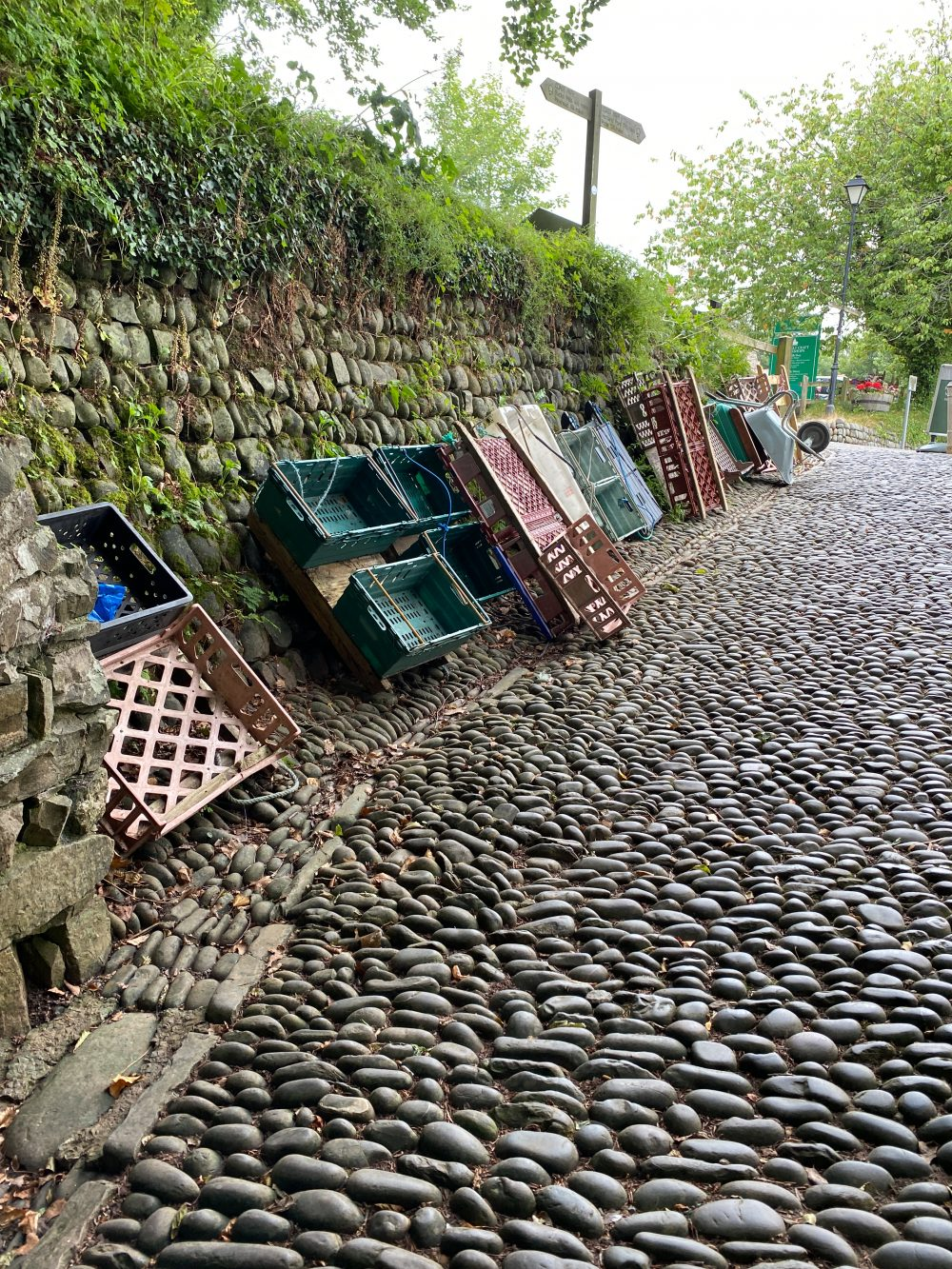 sledges stacked up again the wall on cobbled street