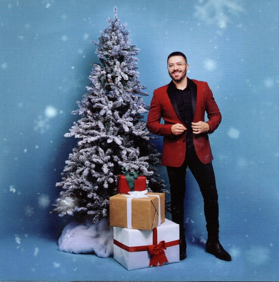 Danny Gokey in front of tree - Greatest Gift CD