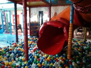 Kool Kids photo – Kool Kids – The mouth of the slide in the big ball pool at Riverside Ice and Leisure.