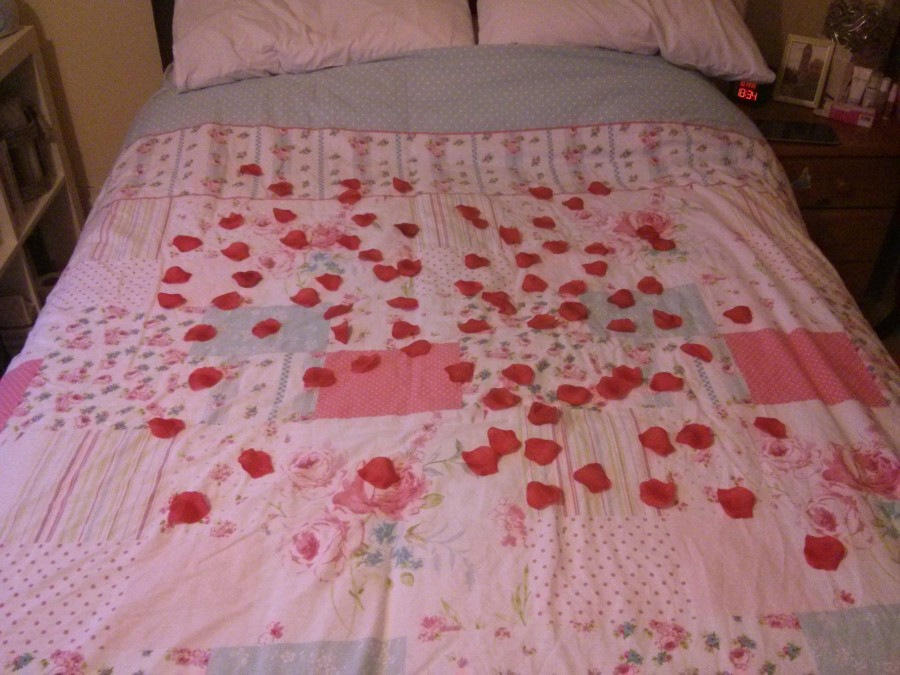 The bed spread with rose petals - Romance at its finest! Taken from DannyUK.com