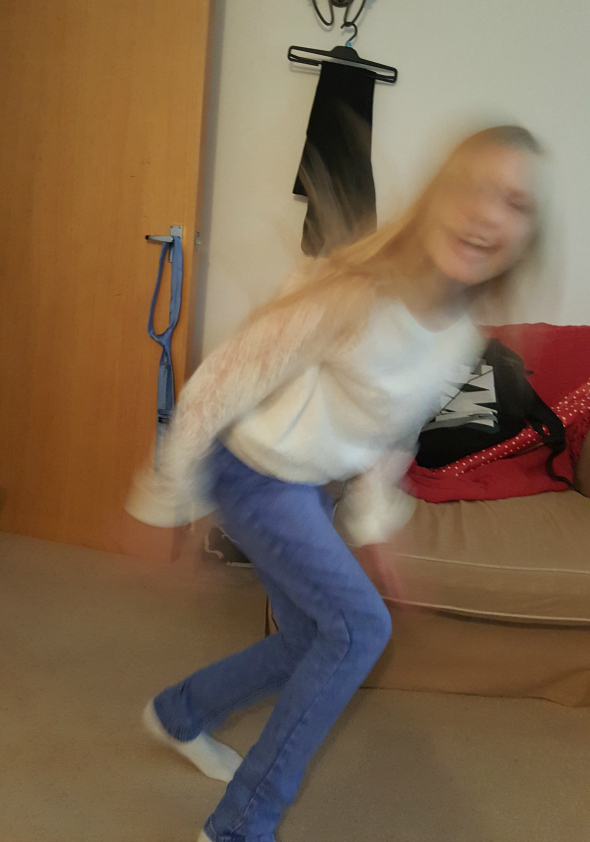 I've chosen an unusual picture for My Sunday Photo this week.  My youngest daughter leaping around. My Sunday Photo - Blurry Brooke - Taken from DannyUK.com