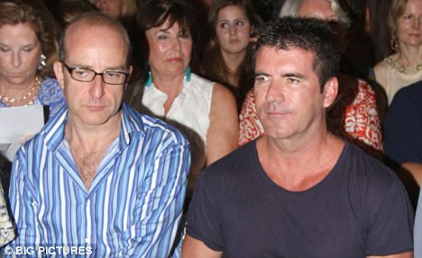 X Factor's Simon Cowell with long-term friend Paul McKenna - Photo from DailyMail.co.uk - Article from X Factor To Be Axed by DannyUK.com