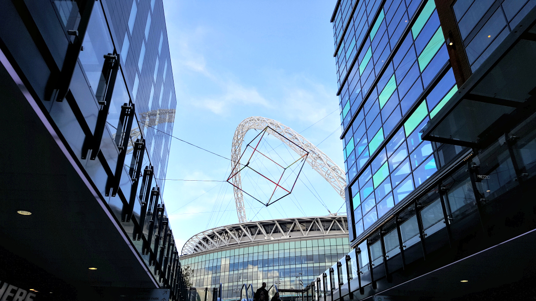 Wembley Stadium arch - with a strange cube structure in the way.