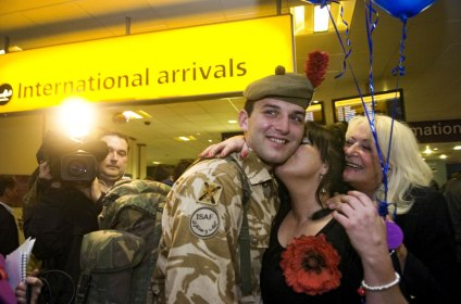A soldier is welcomed home from Afghanistan