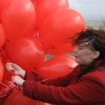 Claire is almost carried away by the balloons