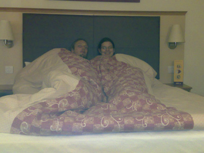 Dan and Faye in bed together