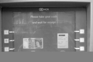 "Cash machine: ""Please take your cash and your receipt."""