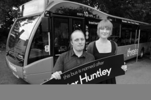My sister Sarah and I at the christening of a bus named after my dad. Click the picture for the full story.
