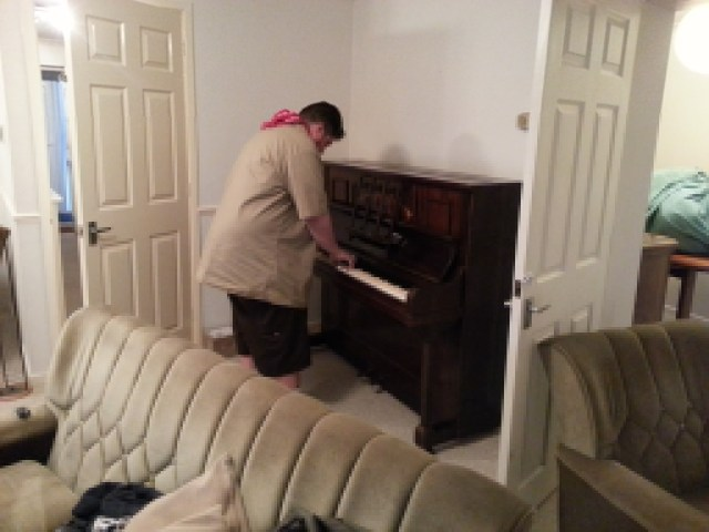 Alec tests the piano at Greendale.
