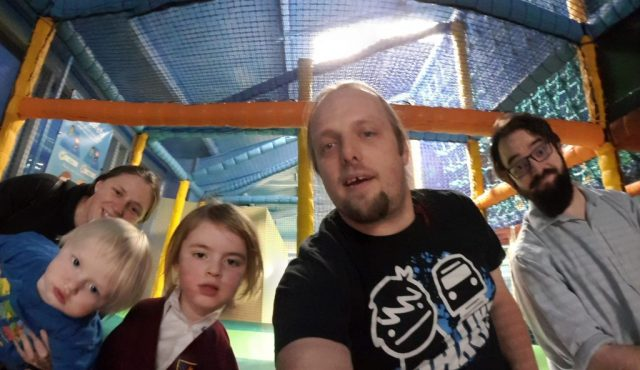 Ruth, Dan, JTA and the kids at the top of the slides at a soft play area.