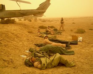 Crew rest for Cobra pilots.  Taken shortly after the sandstorm forced us to land at Camden Yards FARP.  Near to far: Gash, Weasel, IKE, JoJo, Fuse, Spock.  The rain didn't start until nightfall.  25 March 2003 pg 184