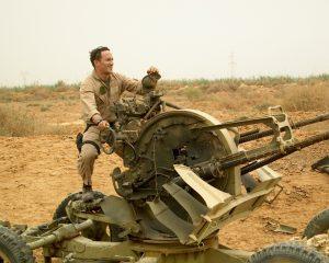 Weasel playing on a destroyed Iraqi ZPU-4 near Salman Pak airfield.