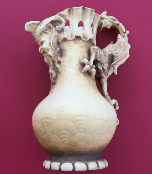 teplitz vase done by artist Alfred Stellmacher with dragon and the north wind on the spout