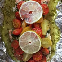 Pesto salmon and tomatoes in foil