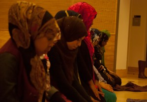 Women participating in the Muslim Student Association's Day of Fasting pray prior to breaking thier fast on Feb. 25, 2014. In the Islamic faith, men and women pray separately whenever possible, either in separate rooms or separate rows.