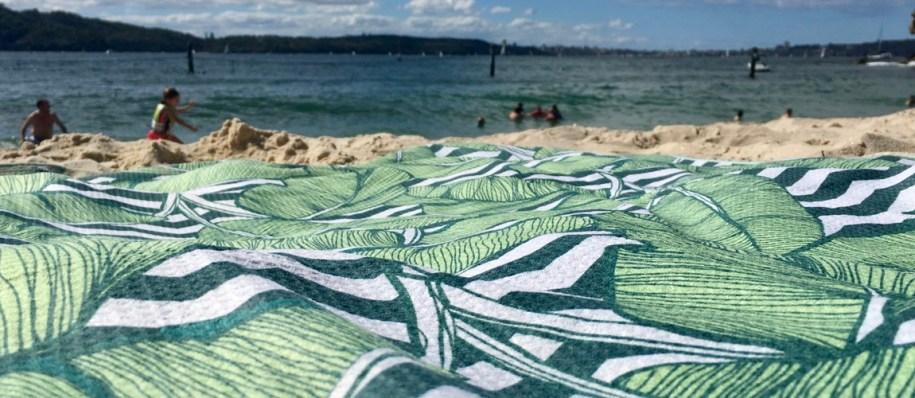 Tesalate Handdoek op het strand in Sydney