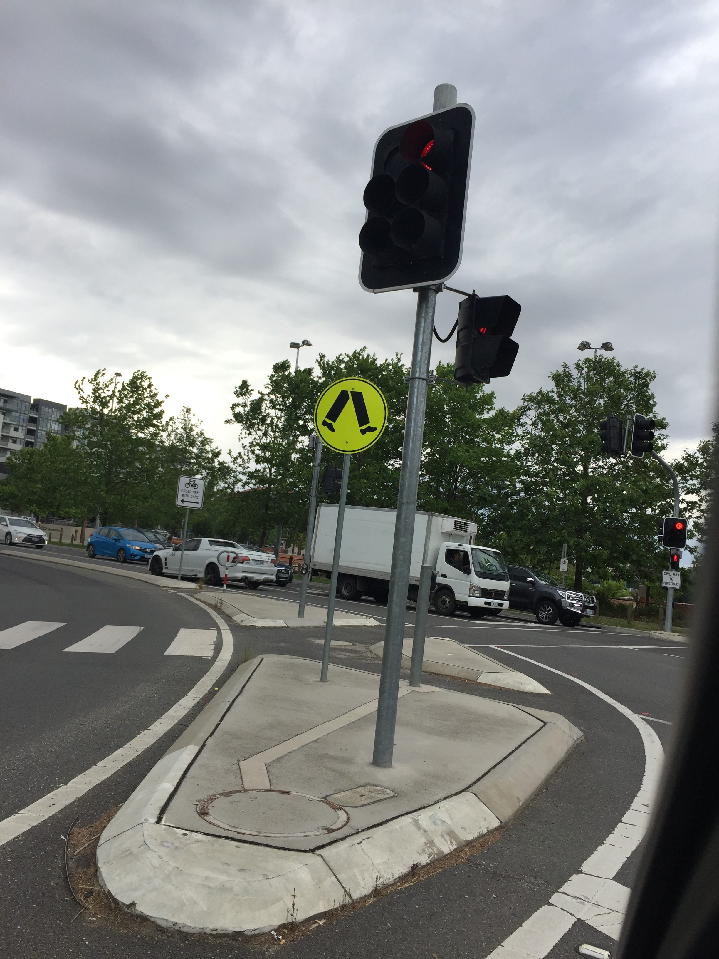 Australian pedestrian crossing sign of random legs
