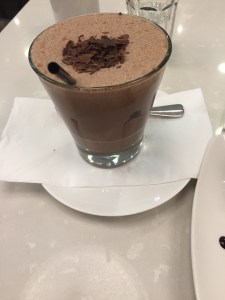 glass of the Vegan Chocolate Frappe with straw, spoon and chocolate shavings at Ganache Chocolate in Melbourne