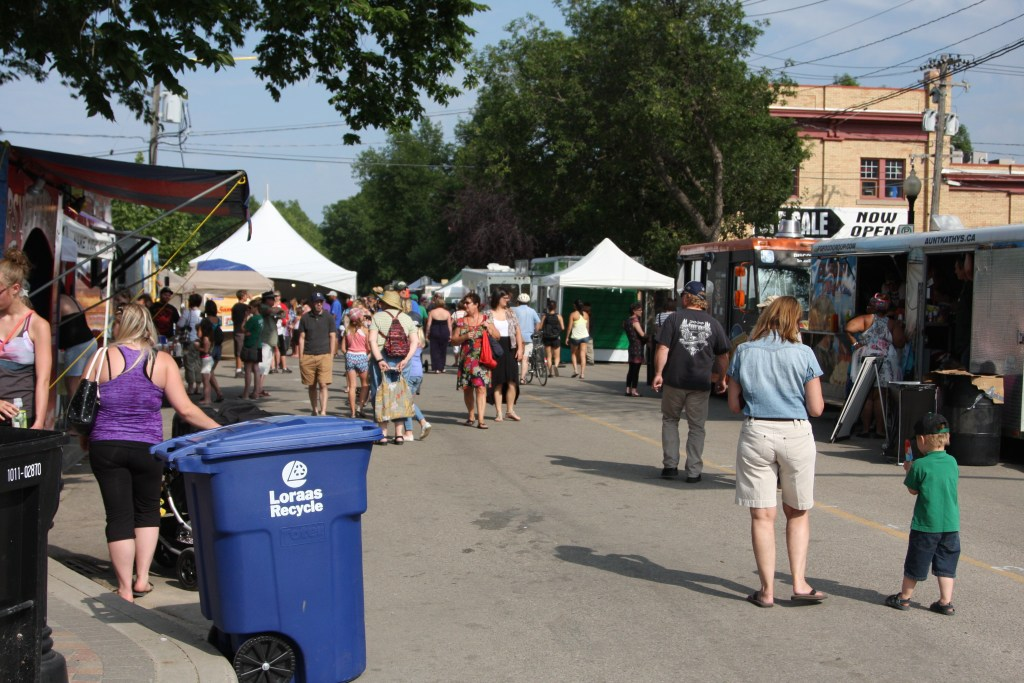 food tents and food trucks on the street for Fringe Fest in Saskatoon