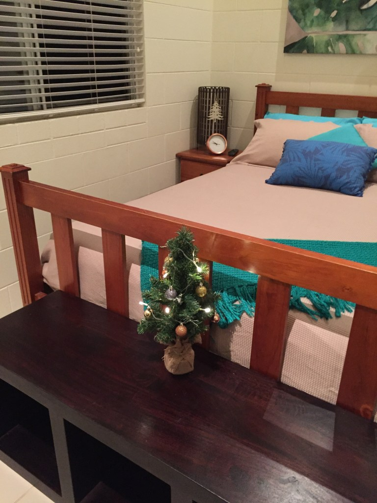 Bed and mini Christmas tree in the Airbnb room in Cairns