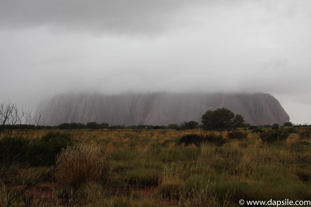 Uluru being devoured by Clouds from a tour from Alice Springs to Uluru