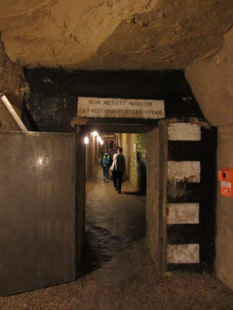 Doorway and Walkway in the Catacombs in Paris