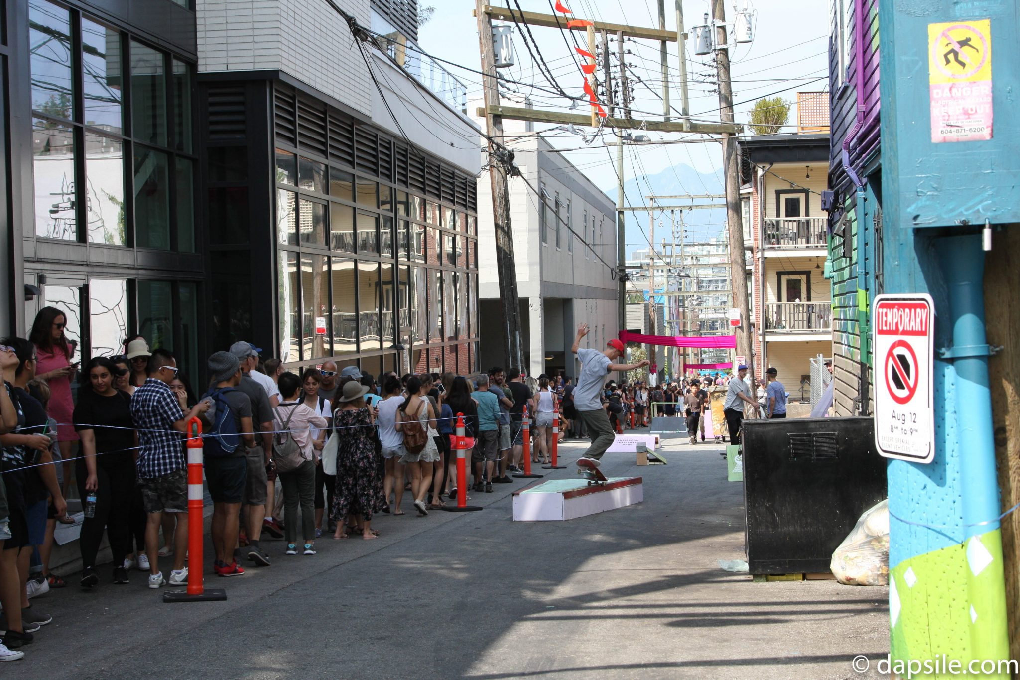 Mural Festival Skaters and Pedestrians Sharing Summer Street Festivals in the Vancouver Area