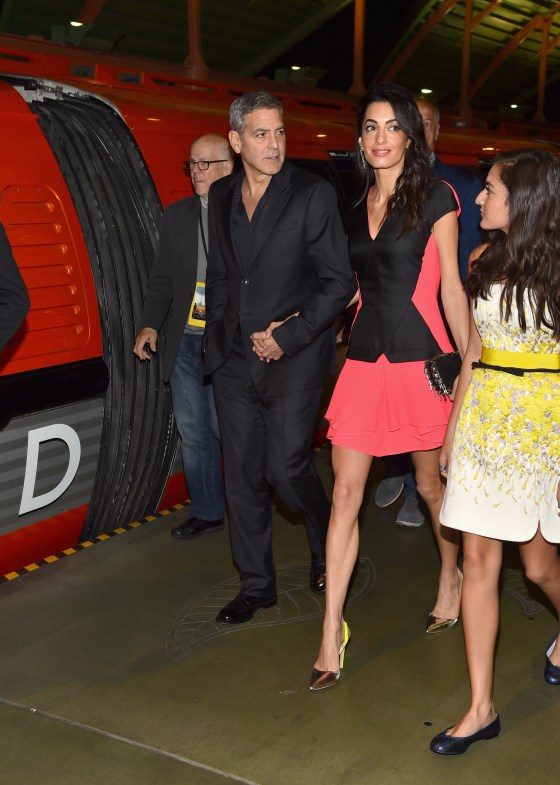 "ANAHEIM, CA - MAY 09: (L-R) Actor George Clooney, lawyer Amal Clooney and Mia Alamuddin attend the after party for the world premiere of Disney's ""Tomorrowland"" at Disneyland, Anaheim on May 9, 2015 in Anaheim, California. (Photo by Alberto E. Rodriguez/Getty Images for Disney) *** Local Caption *** Mia Alamuddin;George Clooney;Amal Clooney"