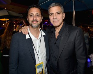 """ANAHEIM, CA - MAY 09: Actors Grant Heslov (L) and George Clooney attend the after party for the world premiere of Disney's """"Tomorrowland"""" at Disneyland, Anaheim on May 9, 2015 in Anaheim, California. (Photo by Alberto E. Rodriguez/Getty Images for Disney) *** Local Caption *** Grant Heslov;George Clooney"""