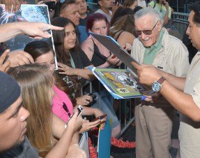 """LOS ANGELES, CA - JUNE 29: Comic book icon Stan Lee signs autographs with fans at the world premiere of Marvel's """"Ant-Man"""" at The Dolby Theatre on June 29, 2015 in Los Angeles, California. (Photo by Charley Gallay/Getty Images) *** Local Caption *** Stan Lee"""
