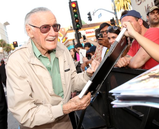 "LOS ANGELES, CA - JUNE 29: Comic book icon Stan Lee signs autographs for fans at the world premiere of Marvel's ""Ant-Man"" at The Dolby Theatre on June 29, 2015 in Los Angeles, California. (Photo by Jesse Grant/Getty Images for Disney) *** Local Caption *** Stan Lee"