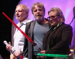 SAN DIEGO, CA - JULY 10: (L-R) Actors Harrison Ford, Mark Hamill, Carrie Fisher and more than 6000 fans enjoyed a surprise `Star Wars` Fan Concert performed by the San Diego Symphony, featuring the classic `Star Wars` music of composer John Williams, at the Embarcadero Marina Park South on July 10, 2015 in San Diego, California. (Photo by Jesse Grant/Getty Images for Disney) *** Local Caption *** Harrison Ford; Mark Hamill; Carrie Fisher