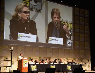 SAN DIEGO, CA - JULY 10: (L-R) Moderator Chris Hardwick, producer Kathleen Kennedy, director J.J. Abrams, screenwriter Lawrence Kasdan and actors John Boyega, Daisy Ridley, Oscar Isaac, Adam Driver, Domhnall Gleeson, Gwendoline Christie, Carrie Fisher and Mark Hamill at the Hall H Panel for `Star Wars: The Force Awakens` during Comic-Con International 2015 at the San Diego Convention Center on July 10, 2015 in San Diego, California. (Photo by Michael Buckner/Getty Images for Disney) *** Local Caption *** Chris Hardwick; Kathleen Kennedy; J.J. Abrams; Lawrence Kasdan; John Boyega; Daisy Ridley; Oscar Isaac; Adam Driver; Domhnall Gleeson; Gwendoline Christie; Carrie Fisher; Mark Hamill