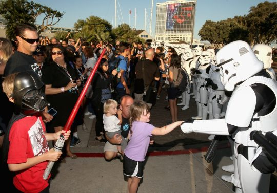 "SAN DIEGO, CA - JULY 10: Following the `Star Wars` Hall H presentation at Comic-Con International 2015 at the San Diego Convention Center in San Diego, Calif., the audience of more than 6000 fans enjoyed a surprise ""Star Wars"" Fan Concert performed by the San Diego Symphony, featuring the classic `Star Wars` music of composer John Williams, at the Embarcadero Marina Park South on July 10, 2015 in San Diego, California. (Photo by Jesse Grant/Getty Images for Disney)"