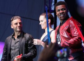 """SAN DIEGO, CA - JULY 10: (L-R) Actors Oscar Isaac, Daisy Ridley, John Boyge and more than 6000 fans enjoyed a surprise `Star Wars` Fan Concert performed by the San Diego Symphony, featuring the classic """"Star Wars"""" music of composer John Williams, at the Embarcadero Marina Park South on July 10, 2015 in San Diego, California. (Photo by Jesse Grant/Getty Images for Disney) *** Local Caption *** Oscar Isaac; Daisy Ridley; John Boyega"""